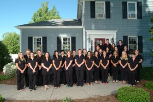 The staff members of Coventina Day Spa in Waterford, PA standing in front of the business