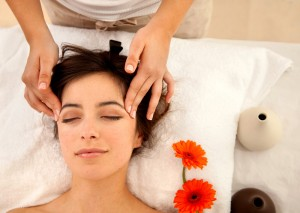 Woman at a spa having a massage in her face